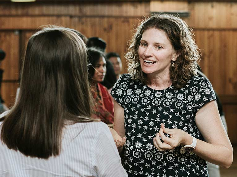 A woman in conversation at CityLight Church North Adelaide.