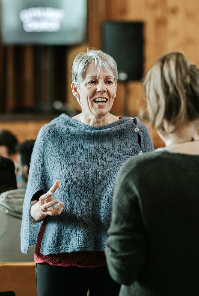 Woman in conversation after a CityLight Church North Adelaide service.