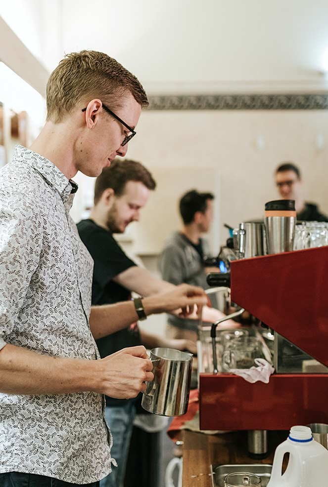 Barista making coffee at CityLight Church North Adelaide.